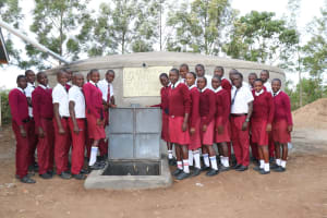 The Water Project: Friends School Ikoli Secondary -  Students Stand Proudly With The Tank