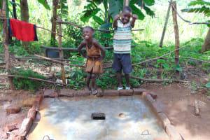 The Water Project: Maondo Community, Ambundo Spring -  Kids With Curing Sanitation Platform