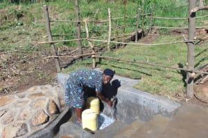 The Water Project: Emurumba Community, Makokha Spring -  Enjoying Spring Water