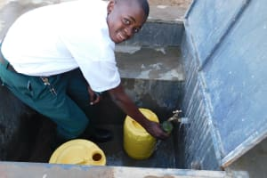 The Water Project: Sawawa Secondary School -  Pupil John Collecting Water
