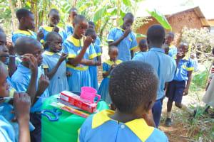 The Water Project: Hobunaka Primary School -  Imitating Toothbrushing