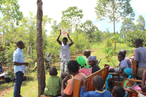 The Water Project: Tumaini Community, Ndombi Spring -  Water Handling Demonstration