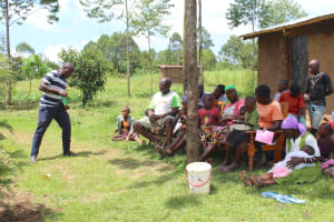 The Water Project: Tumaini Community, Ndombi Spring -  Trainer Amos Talks Solar Disinfection