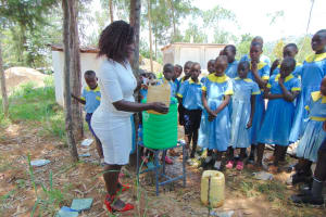 The Water Project: Hobunaka Primary School -  Leaky Tin Demonstration