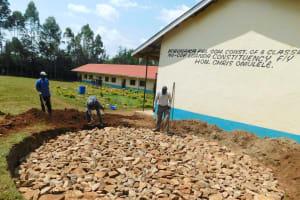 The Water Project: Hobunaka Primary School -  Rain Tank Stone Foundation