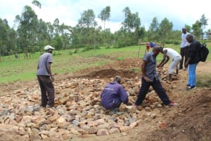 The Water Project: Bugute Lutheran Primary School -  Making Stone Tank Foundation