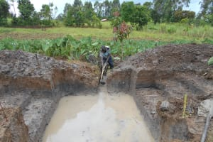 The Water Project: Kalenda A Community, Webo Simali Spring -  Clearing The Drainage Channel