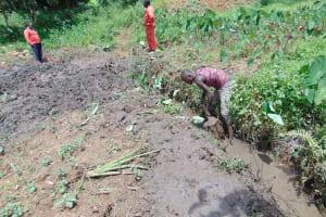 The Water Project: Maondo Community, Ambundo Spring -  Opening Up Drainage Channel