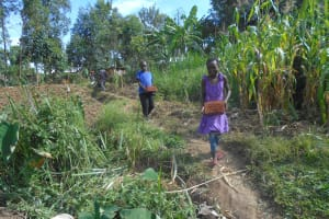 The Water Project: Kalenda B Community, Lumbasi Spring -  Kids Carry Bricks To Site
