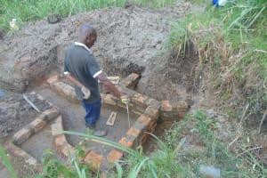 The Water Project: Bukhaywa Community, Shidero Spring -  Wall Construction