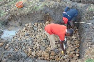 The Water Project: Emurumba Community, Makokha Spring -  Laying The Foundation