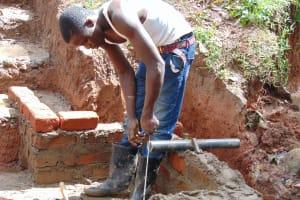 The Water Project: Imusutsu Community, Ikosangwa Spring -  Pipe Measurement And Setting