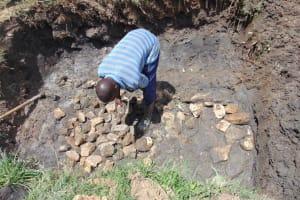 The Water Project: Mukangu Community, Metah Spring -  Laying Foundation