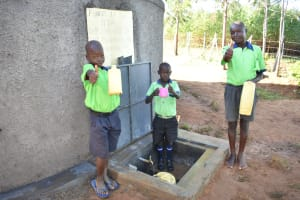 The Water Project: Khwihondwe SA Primary School -  Students With Water For Cooking And Drinking