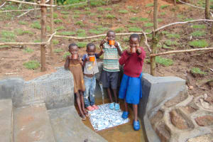 The Water Project: Maondo Community, Ambundo Spring -  Enjoying A Fresh Drink