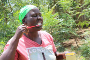 The Water Project: Tumaini Community, Ndombi Spring -  Toothbrushing Session