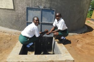 The Water Project: Sawawa Secondary School -  Anabel And Christine Having Fun At The Tank