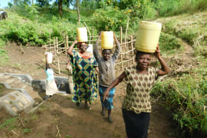 The Water Project: Rosterman Community, Lishenga Spring -  Ready To Bring Clean Water Home