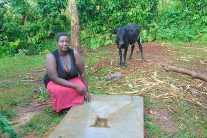 The Water Project: Kitulu Community, Kiduve Spring -  New Sanitation Slab Owner
