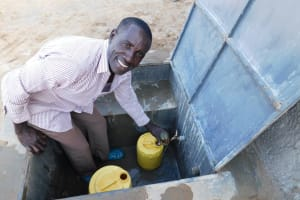 The Water Project: Sawawa Secondary School -  Anthony Mulevu School Watchman Collecting Water