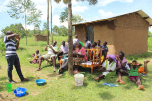 The Water Project: Tumaini Community, Ndombi Spring -  Amos Shows Handwashing Steps
