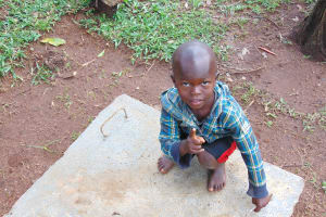 The Water Project: Imusutsu Community, Ikosangwa Spring -  Child Poses With Sanitation Platform