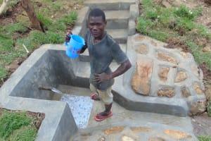 The Water Project: Mukangu Community, Metah Spring -  Enjoying A Fresh Drink
