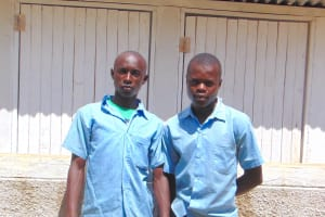The Water Project: Hobunaka Primary School -  Boys Stand Proudly With Latrines