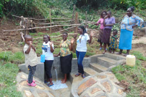 The Water Project: Mukangu Community, Metah Spring -  Women Pose With The Spring