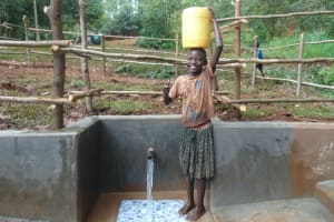 The Water Project: Kitulu Community, Kiduve Spring -  Big Smile For Flowing Water