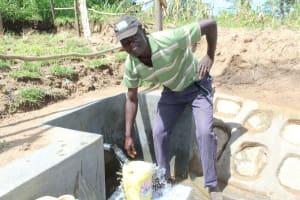 The Water Project: Kalenda B Community, Lumbasi Spring -  Easy Fetching Water