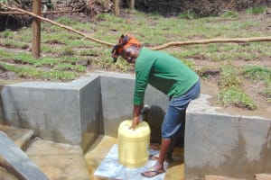 The Water Project: Mubinga Community, Mulutondo Spring -  Smiles While Fetching Water