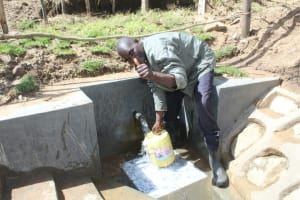 The Water Project: Kalenda B Community, Lumbasi Spring -  Thumbs Up For Flowing Water