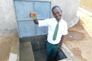 The Water Project: Sawawa Secondary School -  Patrick Holds Up A Clean Drink