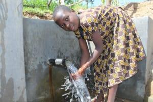 The Water Project: Kalenda B Community, Lumbasi Spring -  Enjoying The Spring Water