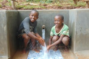The Water Project: Kitulu Community, Kiduve Spring -  Enjoying Spring Water