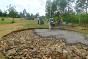 The Water Project: Khwihondwe SA Primary School -  Pouring Concrete Over Stone Foundation