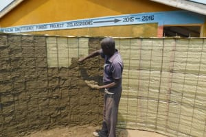 The Water Project: Sawawa Secondary School -  Cementing First Layer Inside Tank