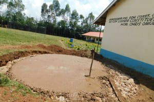 The Water Project: Hobunaka Primary School -  Concrete Added To Foundation