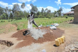 The Water Project: Bugute Lutheran Primary School -  Emptying Bag Of Cement Mix