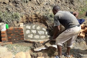 The Water Project: Mwichina Community, Matanyi Spring -  Floor Construction