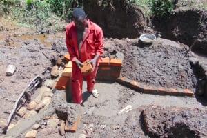 The Water Project: Maondo Community, Ambundo Spring -  Brick Setting