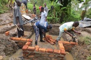 The Water Project: Rosterman Community, Lishenga Spring -  Brick Setting