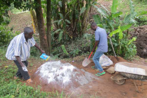 The Water Project: Rosterman Community, Lishenga Spring -  Mixing Cement