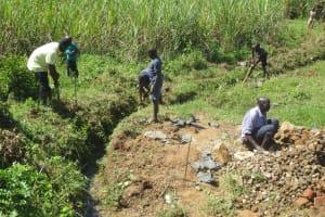 The Water Project: Tumaini Community, Ndombi Spring -  Drainage Clearance