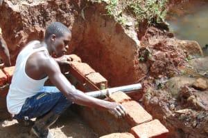 The Water Project: Imusutsu Community, Ikosangwa Spring -  Headwall Measurements