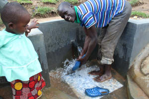 The Water Project: Kalenda B Community, Lumbasi Spring -  Rinsing Off Shoes