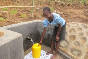 The Water Project: Tumaini Community, Ndombi Spring -  Easy Filling Up Now