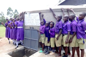 The Water Project: Chiliva Primary School -  Students Pose With Rain Tank