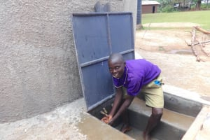 The Water Project: Chiliva Primary School -  Enjoying Rain Tank Water